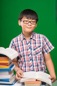 Asian boy reading a book — Stock Photo