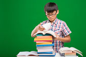 Boy searching information in the books — Stock Photo