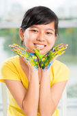 Girl with painted hands forming a bird — Stock Photo