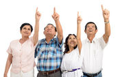 Senior people pointing up — Stock Photo