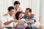 Friends watching something on tablet — Foto de Stock