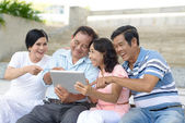 Senior people with tablet PC — Stock Photo