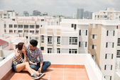Couple dating on the roof — Stock Photo