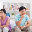 Unhappy married couple on the sofa — Stock Photo #50351827