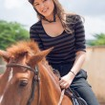 Asian horsewoman — Stockfoto