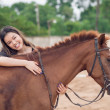Happy girl embracing horse — Stock Photo #50358151