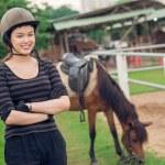 Smiling girl in a helmet — Stockfoto