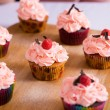 Cupcakes with whipped cream — Stock Photo #50358545