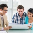 Couple and estate broker looking at the project — Stock Photo #50358591