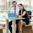 Businesswoman and businessman with laptop — Stock Photo #50358891