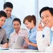 Businessman and his busy employees — Stock Photo #50359465