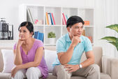 Unhappy married couple on the sofa — Stock Photo