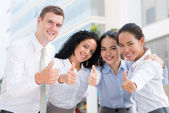 Business team showing thumbs-up — Stock Photo