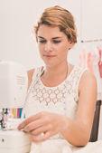 Woman sewing on sewing machine — Stock Photo