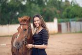 Happy girl with a pony — Stock Photo