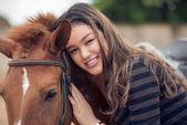 Asian girl and pony — Stock Photo