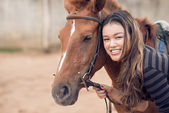 Chestnut pony and girl — Stock Photo