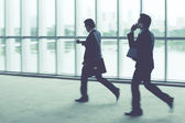 Businesspeople in hurry — Stock Photo