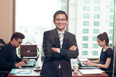 Entrepreneur standing in the office — Stock Photo