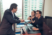 Coworkers talking in the office — Stock Photo