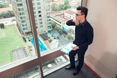Businessman standing by the window — Stock Photo
