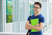 Vietnamese student with a textbook — Stock Photo