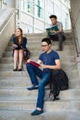 Students sitting on the stairs — Stock Photo