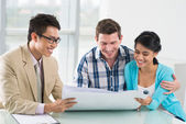 Couple and estate broker looking at the project — Stock Photo