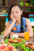 Bored girl with chopsticks — Stock Photo