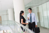 Coworkers talking in the office building — Stock Photo