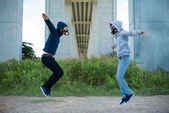 People in the respirators jumping — Stock Photo