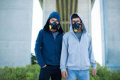 Vietnamese people in gas masks — Stock Photo