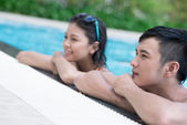 Couple resting in the swimming pool — Stock Photo