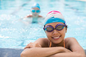 Lovely swimmer wearing goggles — Stock Photo
