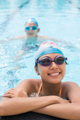 Proud female swimmer in a pool — Stock Photo
