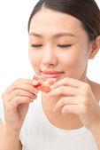 Woman smelling tomato — Stock Photo