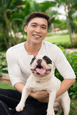 Asian man with a French bulldog — Stock Photo