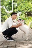 Man playing with dog — Stock Photo