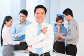 Confident team leader and managers — Stock Photo