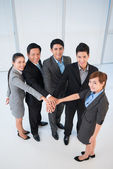 Office managers stacking their hands — Stock Photo