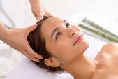 Asian girl receiving head massage — Stock Photo
