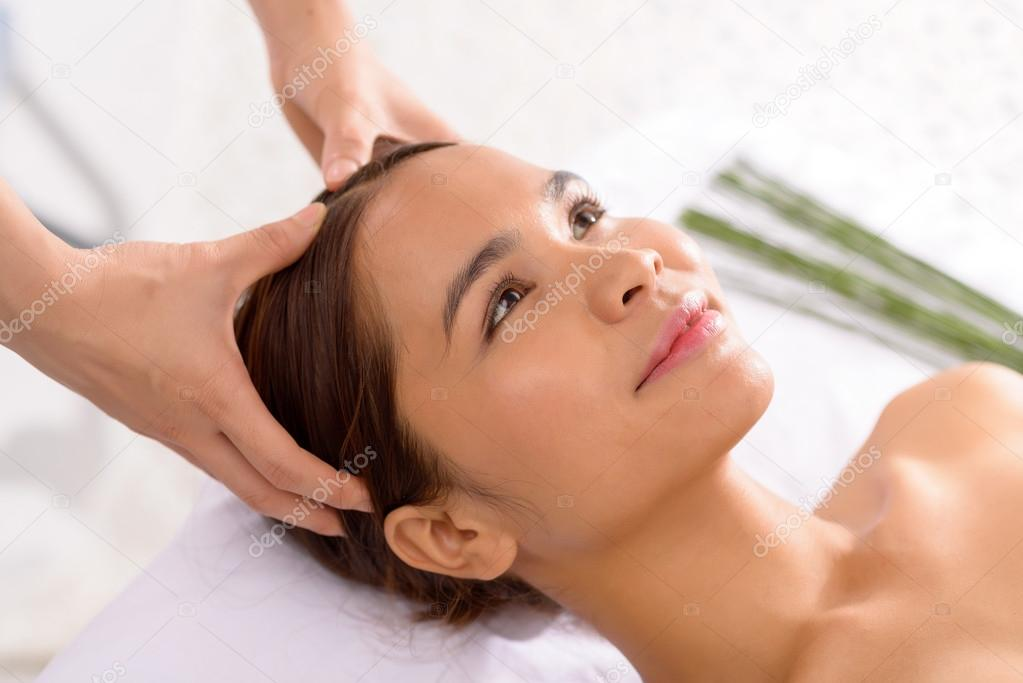 Asian girl receiving head massage — Stock Photo © DragonImages ...