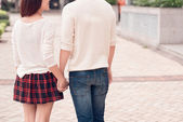 Couple walking hand in hand — Stock Photo