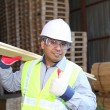 Man moving wood in a warehouse — Stock Photo