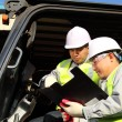 Manager talking to forklift operator — Stock Photo #16764321