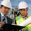 Businessman and industrial engineer — Stock Photo