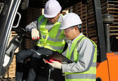 Manager talking with forklift operator — Stok fotoğraf