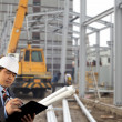 Construction site and architect — Stock Photo