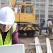 Foreman construction site using laptop — Stock Photo