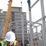 Foreman construction site using laptop — Stock Photo #18813303
